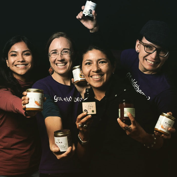 West coast agave group photo, holding products